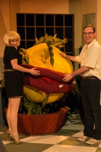 Audrey (Jennifer Redston) and Seymour (Niclas Olson) flank Audrey II.