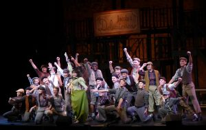 The cast of Disney's Newsies celebrates victory for the newsboys. Photo credit Kat Dollarhide.