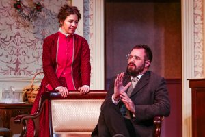 "Nora (Annie Katica Green) & Torvald (Sean Neely) in Tacoma Little Theatre's "" A Doll House."""