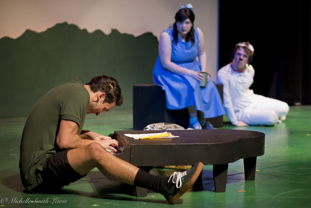 "Left to right, Jeffery Wallace as Schroeder, Corissa Deverse as Lucy, and Jake Atwood as Snoopy in Centerstage's ""You're a Good Man, Charlie Brown."""