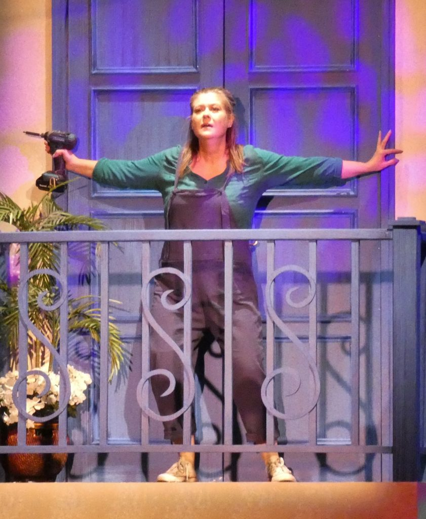 Linda Palacios taking care of building maintenance as Donna, in TMP's Mamma Mia.